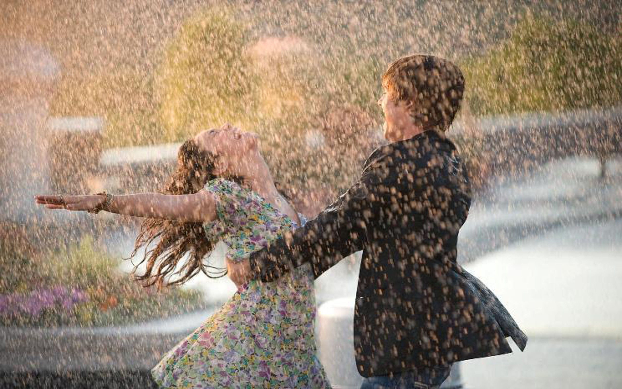 http://unfoldinglove.com/wp-content/uploads/2012/07/rain-happy-couple.jpg