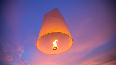 Floating lanterns in the evening sky at Thailand